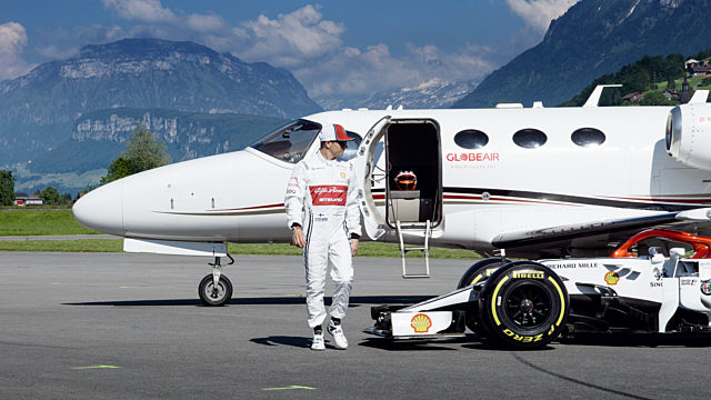 Kimi Räikkönen in front of a GlobeAir private jet