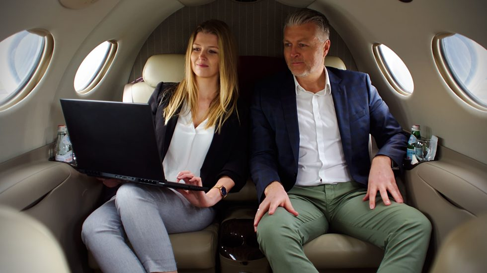 Business partners on board private jet