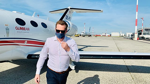 Pax with mask on a private jet